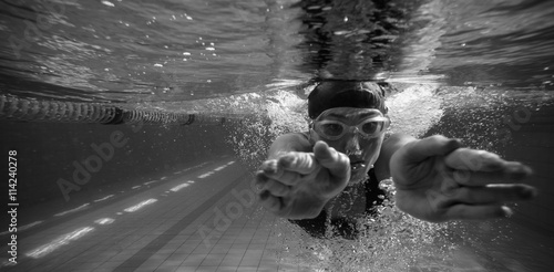 Athletic swimmer training on her own Canvas Print