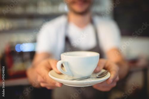Close-up of barista serving coffee at cafeteria Tapéta, Fotótapéta