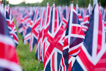 British United Kingdom UK Flags In A Row With Front Focus And The Further Away Symbols Blurry With Bokeh. The Flags Were Set Up On Memorial Day In DC.