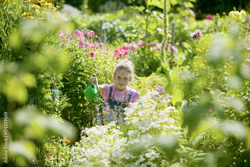 Papiers peints Jardin Girl watering flowers in garden