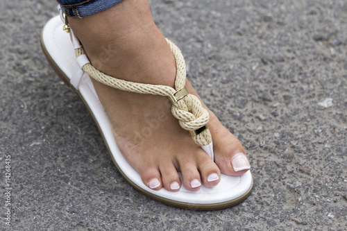 95865e340594f Foot girls fashion sandals with a beautiful pedicure on the road ...