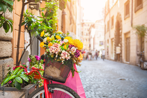 Poster Fiets Bicycle with flowers in the old street in Rome, Italy