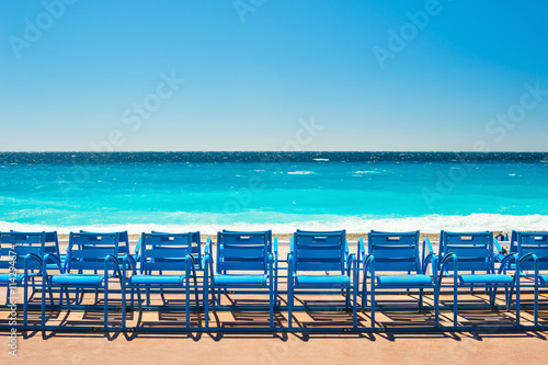 Spoed Foto op Canvas Nice Blue chairs on the Promenade des Anglais in Nice, France