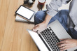 man with laptop computer, coffee cup and tablet - top view