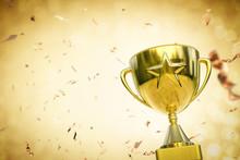 Gold Star Trophy On Gold Glitter Background