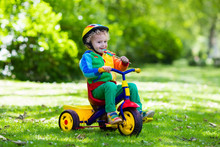 Little Boy On Colorful Tricycle