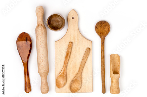 Valokuva  Kitchen wooden cutting board and wooden spoons flat lay