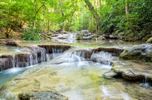 Beautiful Waterfall And Tropical Forests At Erawan National Park Is A Famous Tourist Attraction In Kanchanaburi Province, Thailand
