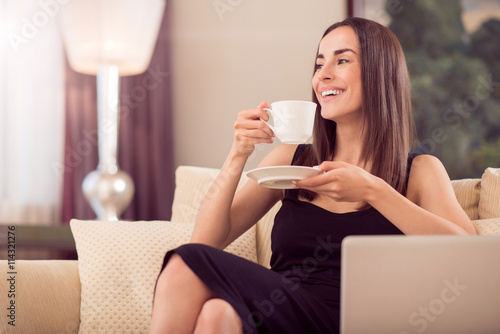 obraz dibond Beautiful woman holding cup of coffee