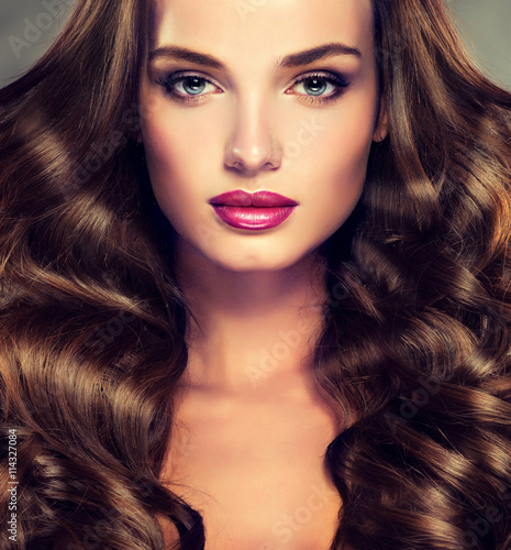 Fotografie, Obraz  Beautiful girl brunette  hair with an elegant hairstyle , hair wave ,curly hairstyle
