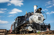 Old train engine from the west with blue sky and clouds