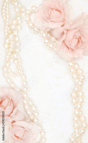 Feminine background with roses and pearls