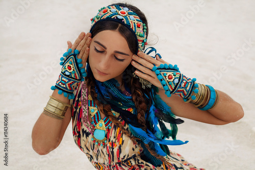 fototapeta na lodówkę attractive young woman in ethnic jewelry outdoors