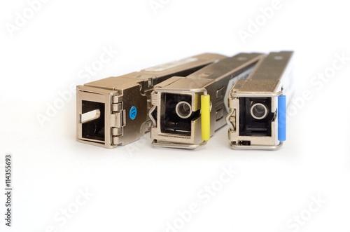 Fotografie, Obraz  Optical gigabit sfp module for network switch isolated