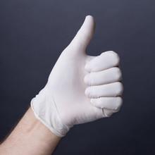 Male Hand In Latex Glove