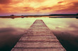 Old Wooden Pier, Calm River At Colorful Sunset Sunrise