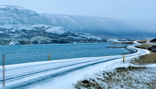 Deurstickers Scandinavië frozen winding road the ocean shores in Iceland