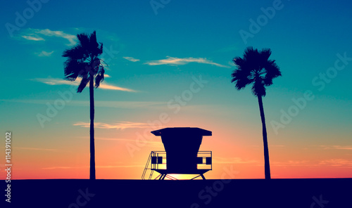 Foto auf Gartenposter Strand Vintage Lifeguard Tower - Vintage Lifeguard Tower on Beach at sunset in San Diego, California