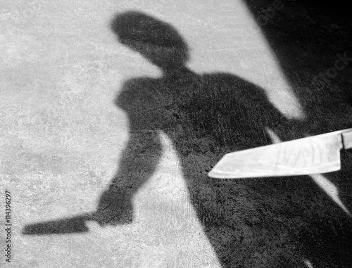 Fotografie, Obraz  Shadow man raised a knife to stab