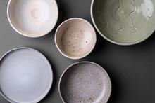 Ceramic Bowls On Grey Background