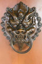 Dragon Head Door Knockle On The Light Brown Wallpaper In Chi Lin Temple , Hong Kong