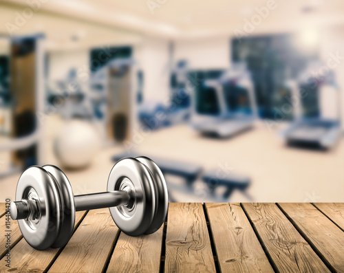 Fotografia  metal dumbbell with gym background