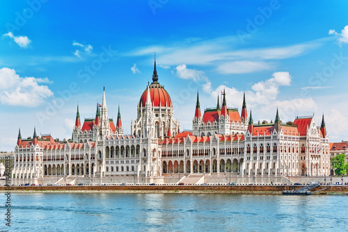 Photo  Hungarian Parliament at daytime. Budapest. View from Danube rive
