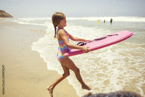 c54bfd1b152 Cute little girl playing at the beach on summer vacation - Buy this ...