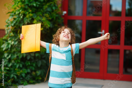 Fotografie, Obraz  Little school student rejoices to the termination of academic year