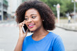Happy woman from Africa at phone