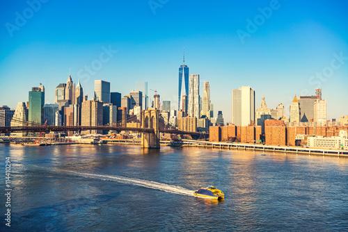Brooklyn bridge and Manhattan at sunny day, New York City Canvas Print