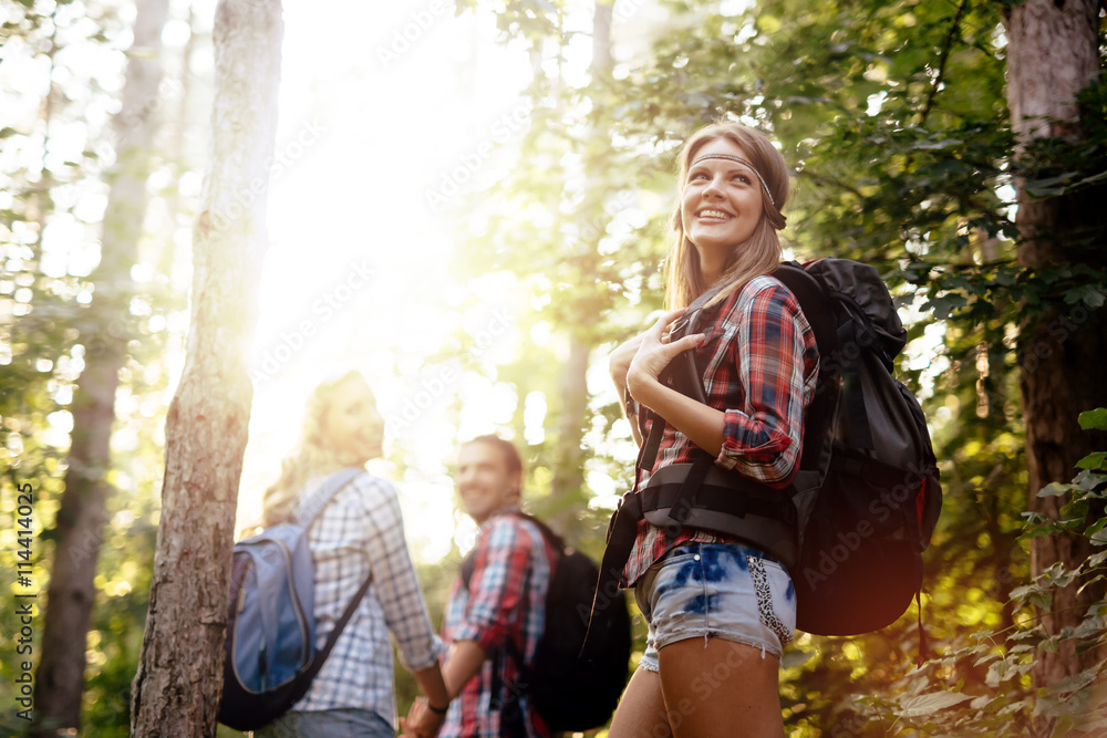 Fototapety, obrazy: People trekking in forest