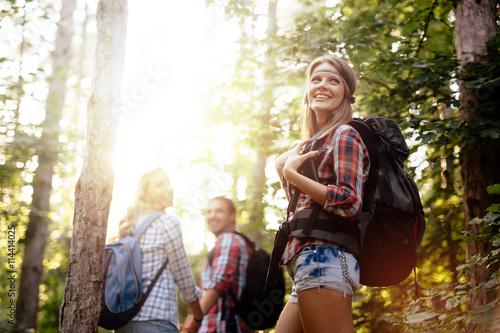 Obraz People trekking in forest - fototapety do salonu
