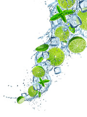 Naklejka Fresh limes in water splash.