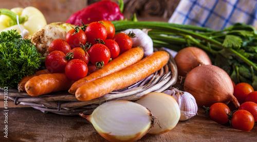 Vegetables on old vintage table. - 114421032