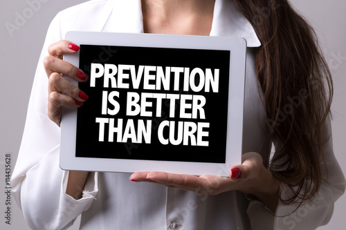 Fotografie, Obraz  Female doctor holding a tablet with the text: Prevention is Better Than Cure