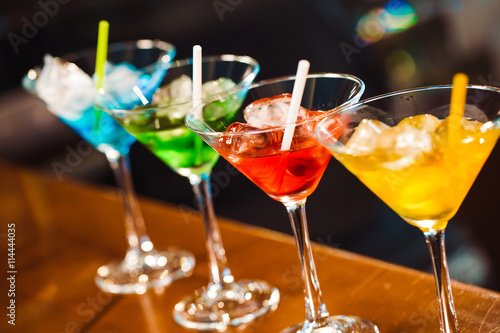 Photo  Multicolored cocktails at the bar.