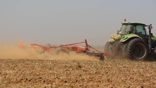 Tractor Working In The Field H...