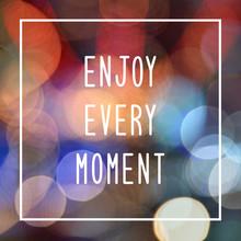 Enjoy Every Moment On Bokeh Lights Background