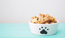Dog Treats In A Bowl On Wooden Table