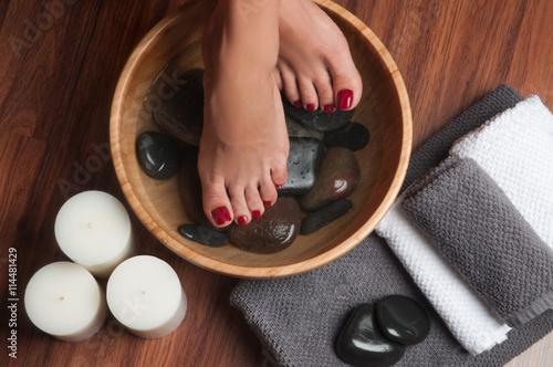 Manicured female feet in spa pedicure procedure