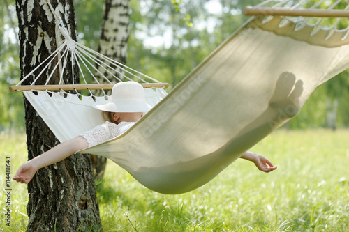 Photo  Woman resting in hammock.