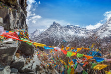 The Buddhist Tibetan Prayer Flags On The Top Of Mountain