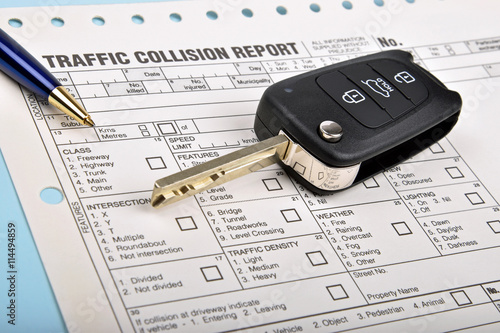 crash report form and car key - buy this stock photo and explore