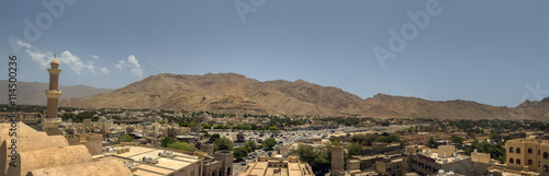 Fotobehang Midden Oosten Aerlial view of Nizwa oasis and surrounding mountains