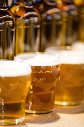 Close-up of beer glasses on the bar counter Canvas Print