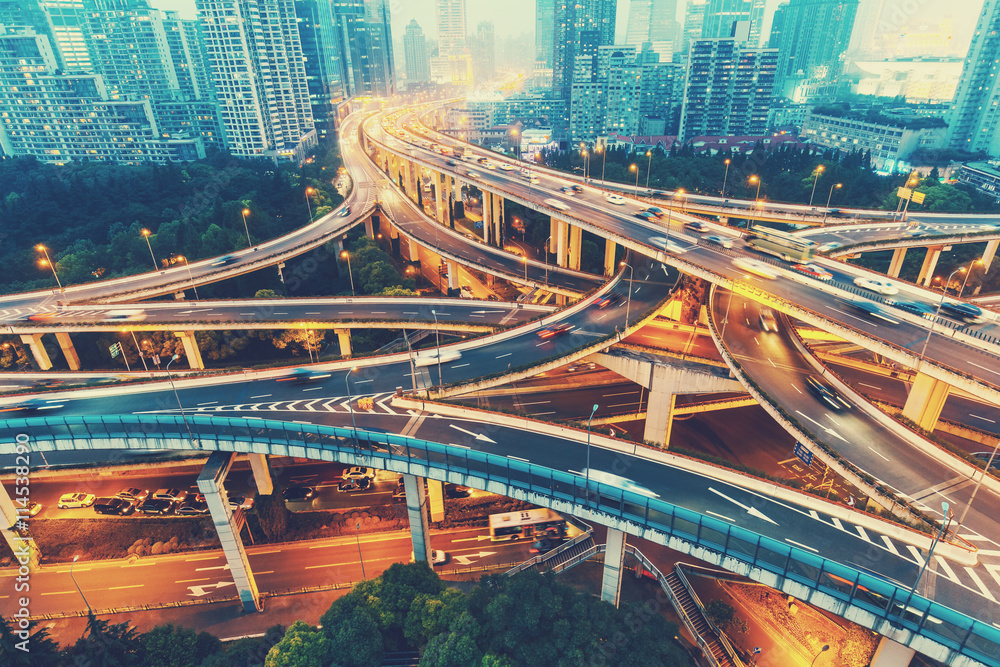 Fototapety, obrazy: View over the famous Dragon highway intersection in Shanghai, China, with traffic. Shanghai skyline in the evening.