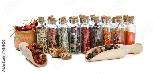 Canvas Prints Spices Assorted dry spices in glass bottles on white background