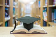 Graduation Cap Over Open Books...