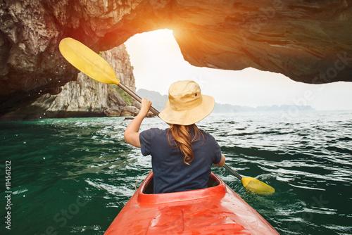Vászonkép Woman explore Ha Long Bay on kayak